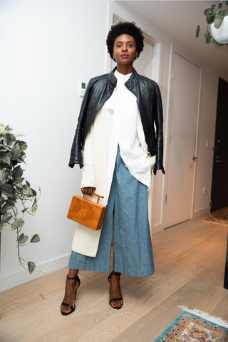 Fall Transition Outfit: White Mandarin Collar Shirt Dress, Blue Culottes, with cream cashmere coatigan and leather jacket layered atop. Paired with cedar wood clutch bag and platinum and gold jewelry
