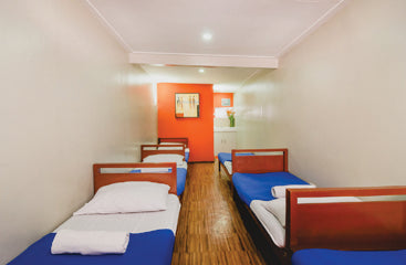 Deluxe barkada room single beds at Metro Deluxe Residences