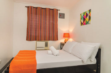 Standard Rooms at Metro Deluxe Residences - Bed