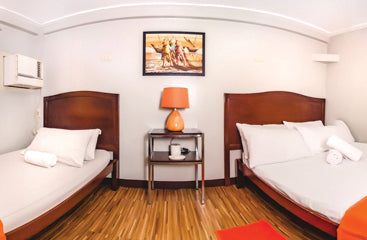 Deluxe triple room beds at Metro Deluxe Residences