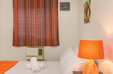 Standard Rooms at Metro Deluxe Residences - Aircon Room