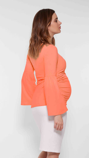 Stowaway Collection Bell Sleeve Maternity Top in Coral Back View