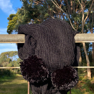 incredibly lightweight warm black alpaca scarf with pom poms australian made