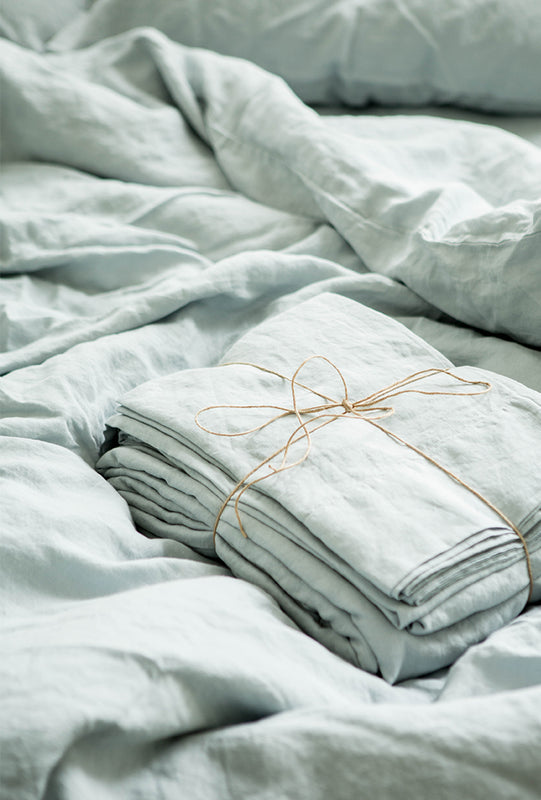 Misty Blue French Linen bedsheets folded up