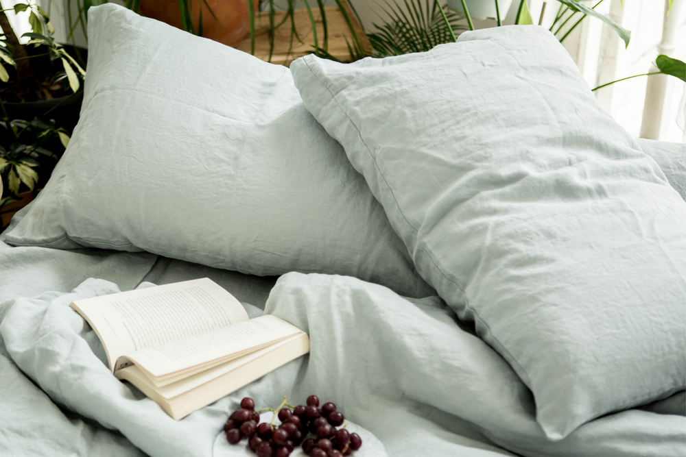 Misty Blue French Linen Bed with book and grapes