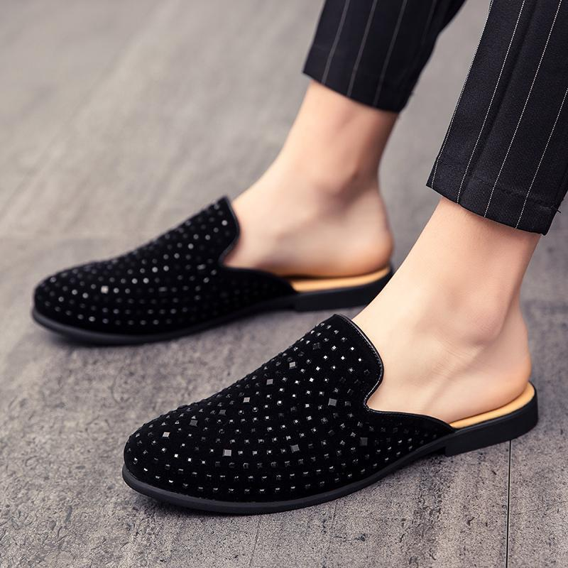 Half-towed slippers men 2019 new small leather shoes with no heel lazy slippers men net red rivet big trend generation.