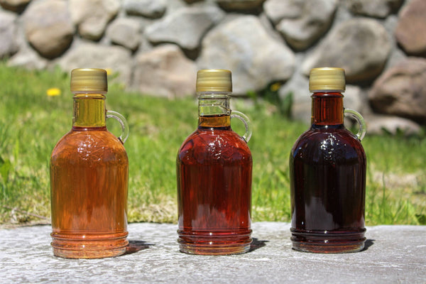 three 250ml glass bottles of Vermont Maple Syrup