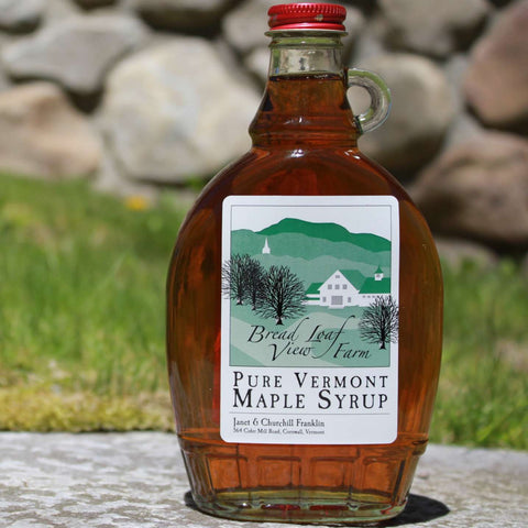12 oz glass bottle of vermont maple syrup with red cap