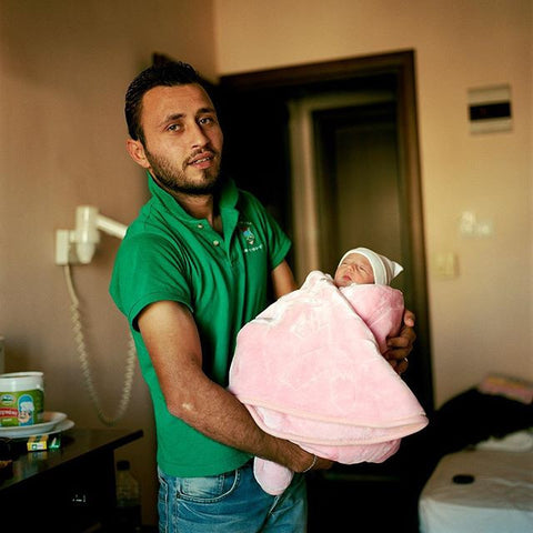 Refugee Support Europe - 3 day old baby at the camp