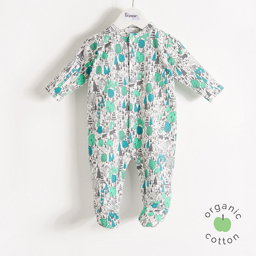 the bonniemob banter sleepsuit for babies, green woodland print