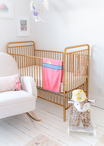 Gold baby crib from Babyletto