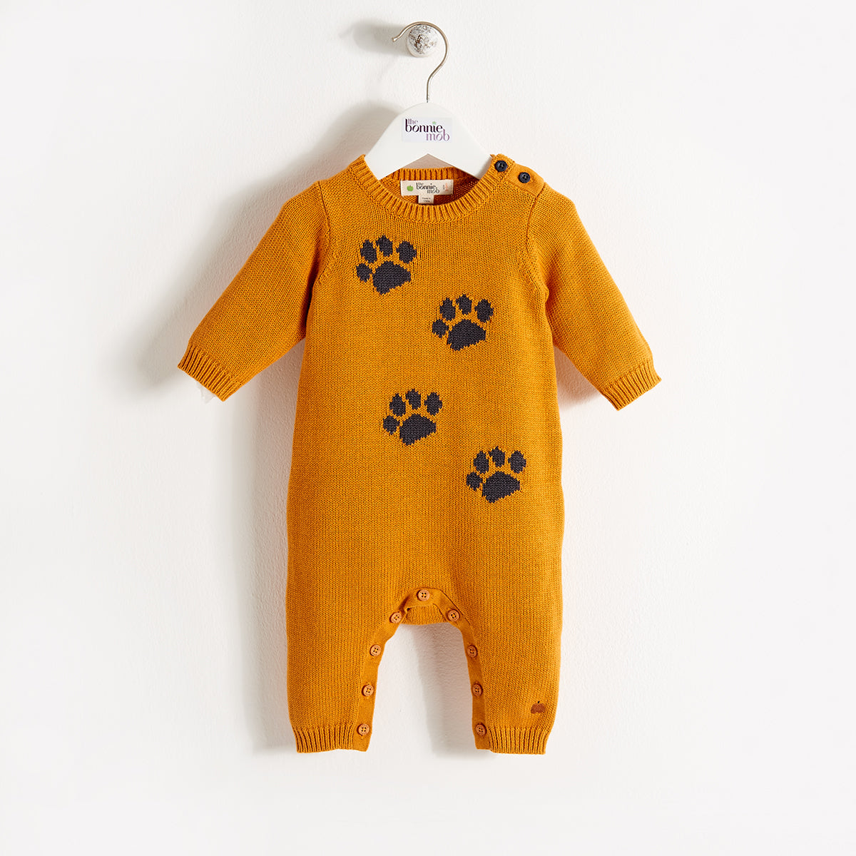 paw print baby playsuit