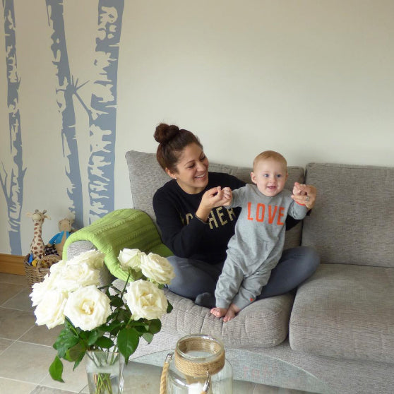 Tricia Rosas wearing Mother Love jumper and baby playsuit