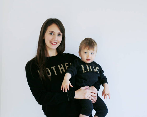 Rebecca Raynham wearing Mother Love jumper and baby playsuit