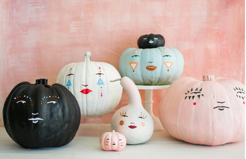 pastel pumkins with faces from the house that lars built