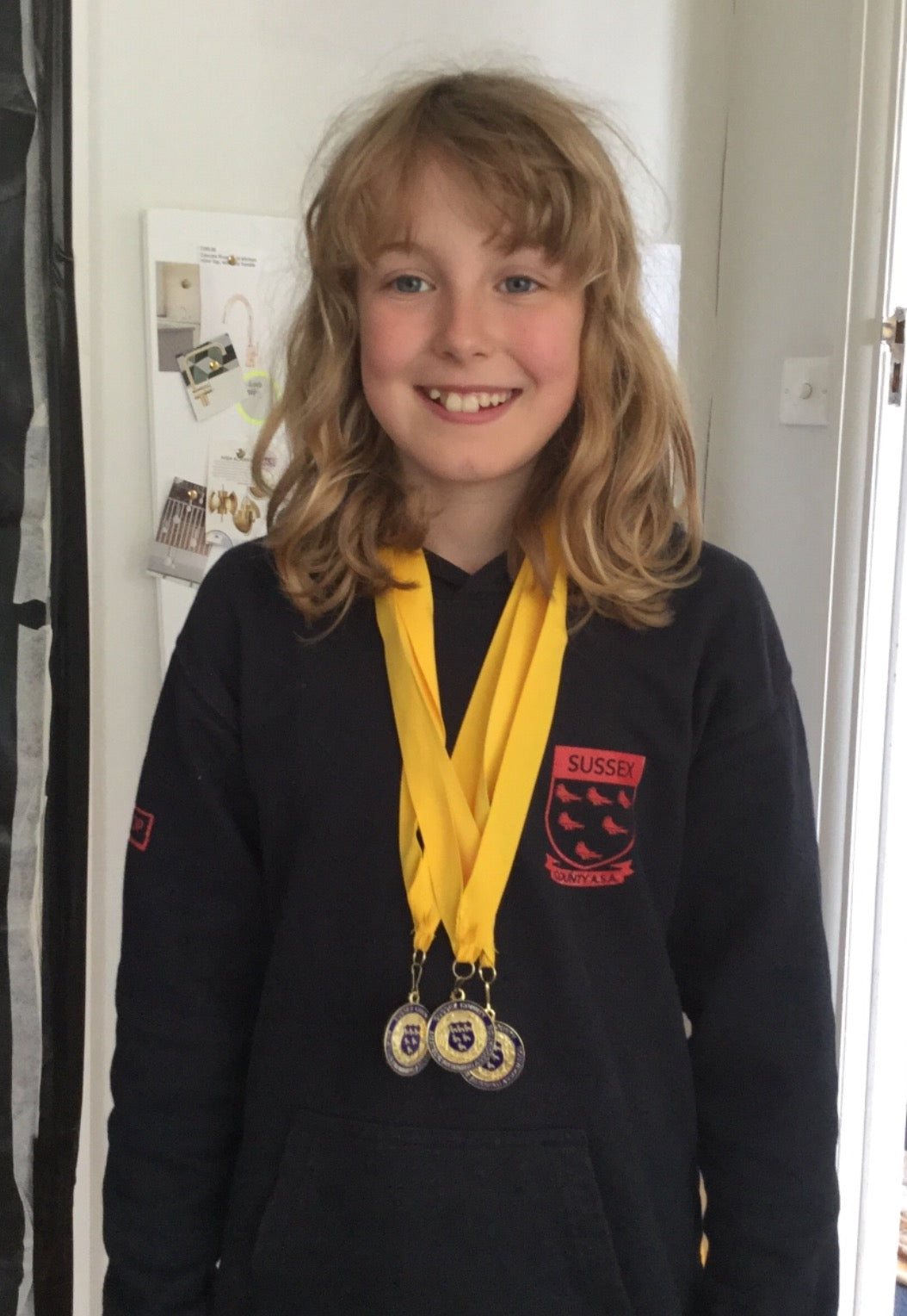 Alice and her gold swimming medals