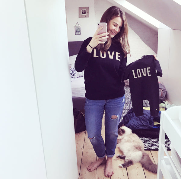 Izzy Judd wearing LOVE sweater from The bonnie mob X Selfish Mother collection