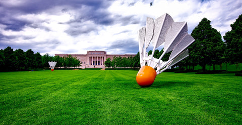 A view of the lawn at the Nelson-Atkins art museum in Kansas City, with the famous shuttlecock statues.