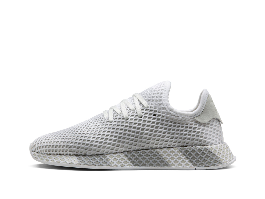 brand new e60af 05342 Visually, the Consortium Deerupt sets itself apart through a striking  3-stripes mark placed across the entire shoe, Consortium-branded  sockliners, ...