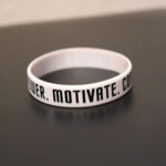 Empower Motivate Conquer Adult White Wristband - Deviant Sway