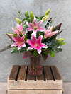 Lilies in Bloom Vase Arrangement