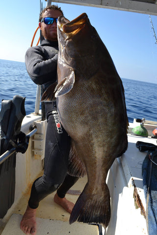 DJ Skelton Holding Huge Grouper on Boat in Gulf of Mexico