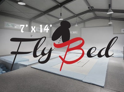 7x14 Flybed Trampoline with stylized writing over the image