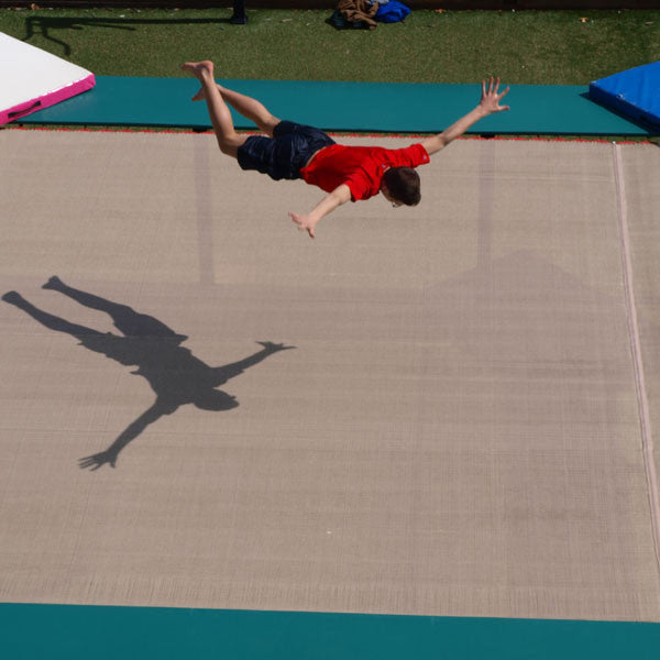 An athlete practicing extreme sports tricks on a trampoline