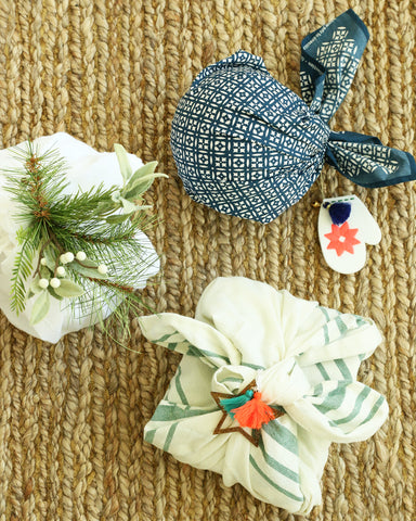 furoshiki fabric wrapped gifts with ornaments