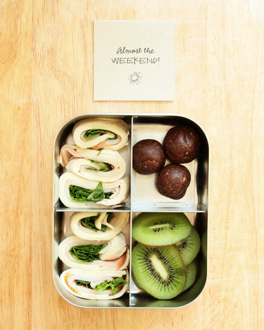metal lunchbox with turkey wrap kiwi and energy balls
