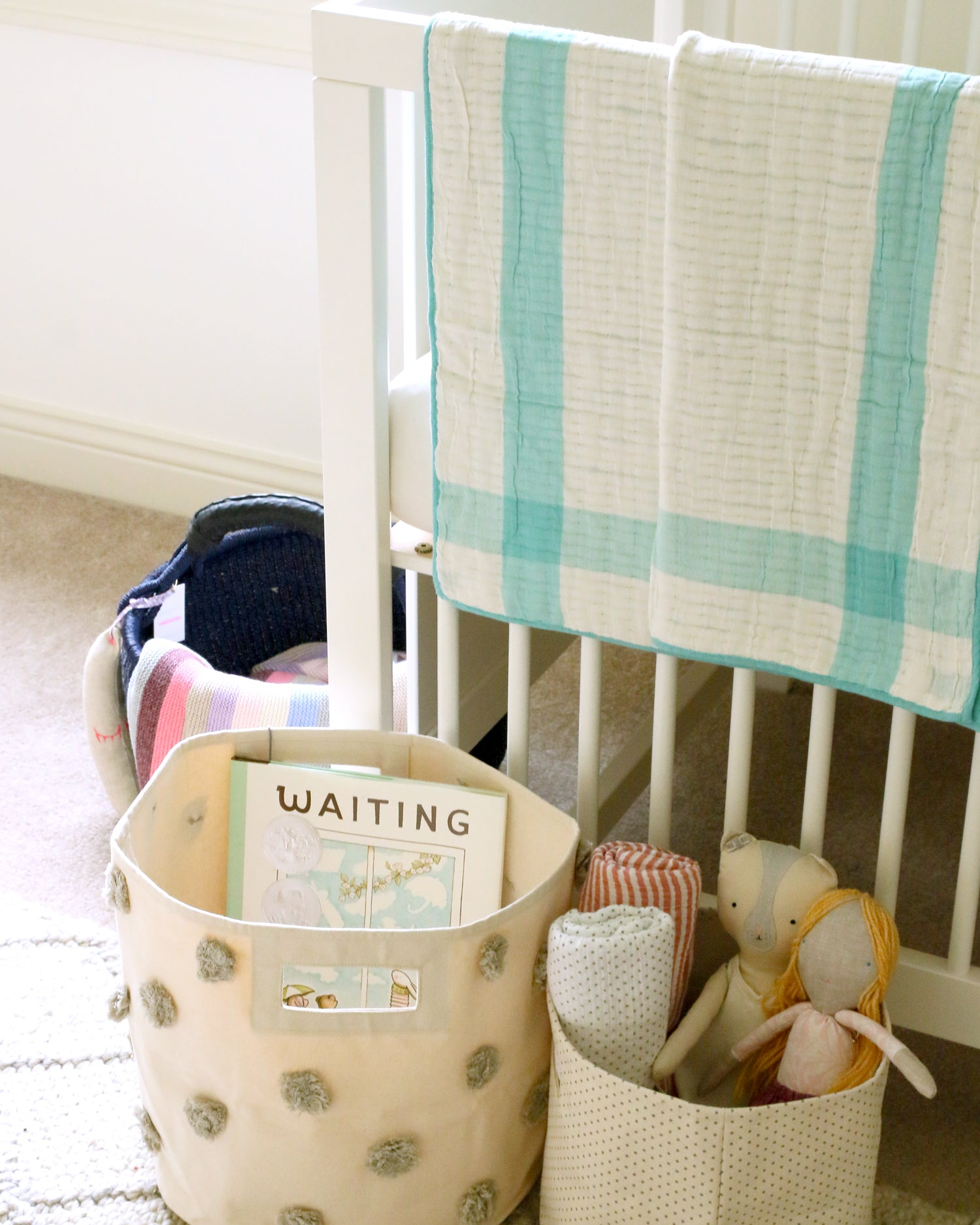 cute girl's nursery baskets with books and soft toys