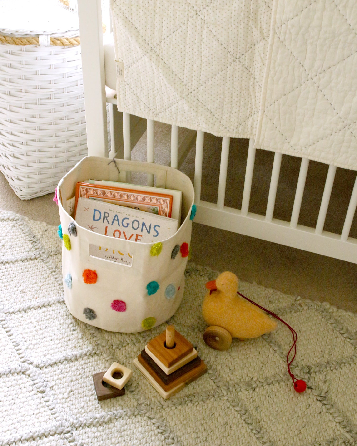 books, wood toy and duck in neutral nursery