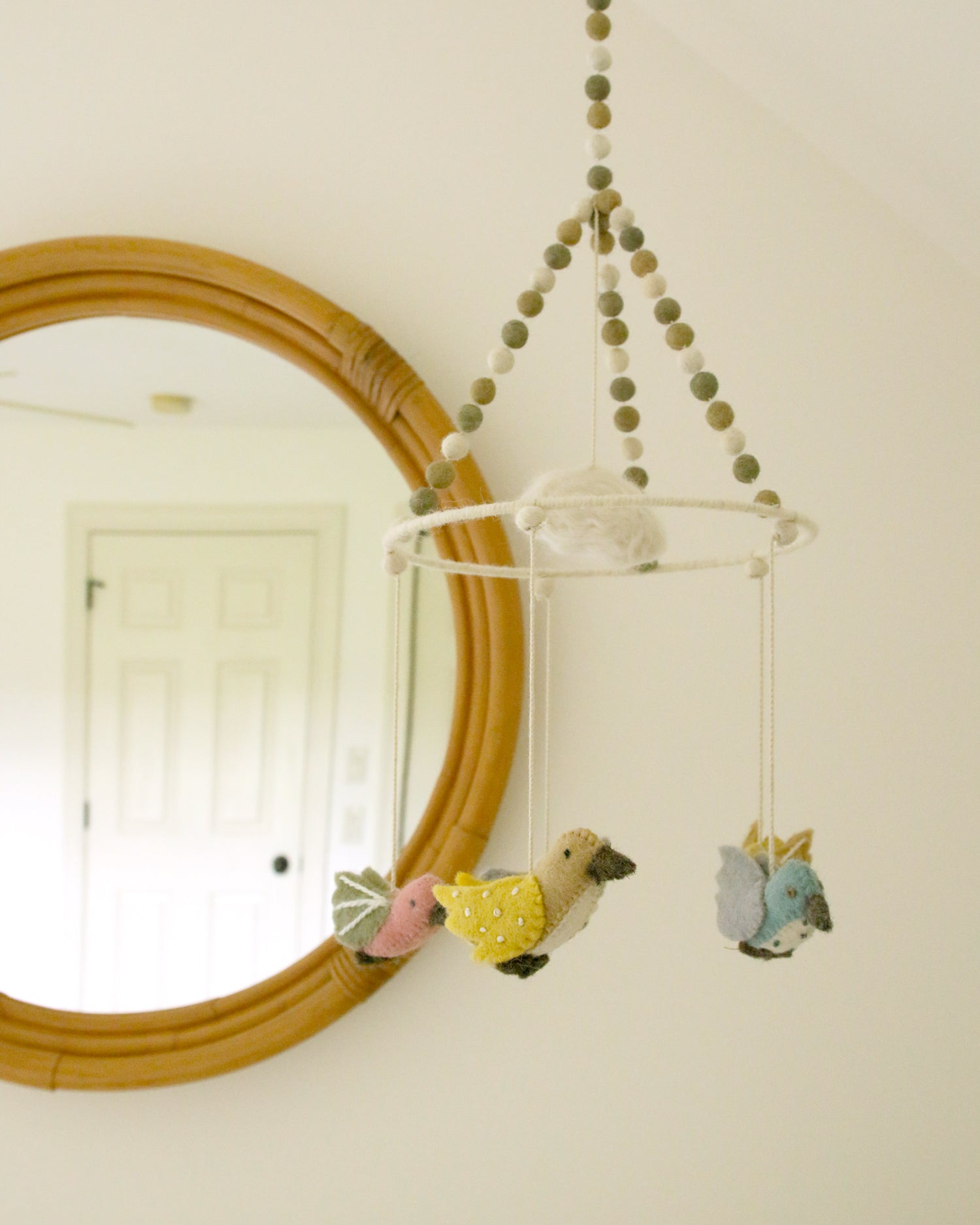 cute sparrow mobile in baby's neutral nursery