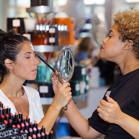 Woman gets a makeover from a Beauty Expert at a Bluemercury Store
