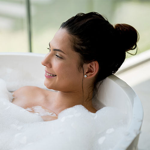 A woman lounging in the bath