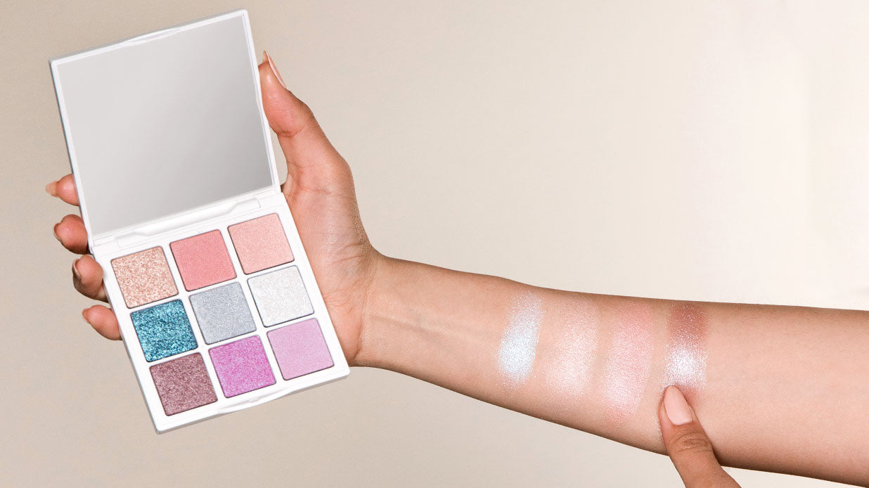 Open Chantecaille Polar Ice Eye Palette and eyeshadow swatches on arm