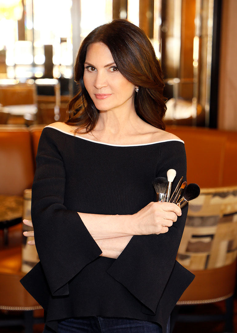 Trish McEvoy holding makeup brushes