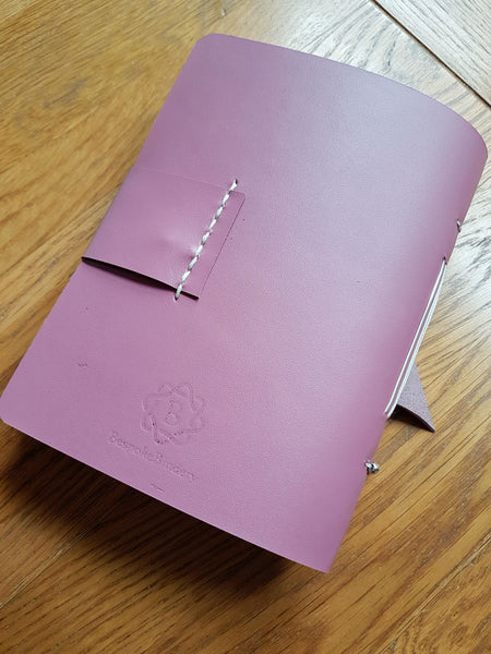 reverse view showing Bespoke bindery logo of A6 leather travel journal notebook in lilac