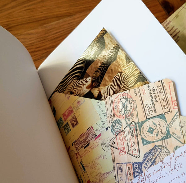 Personalised leather travel journal A5 size with keepsake pockets, maps and travel images