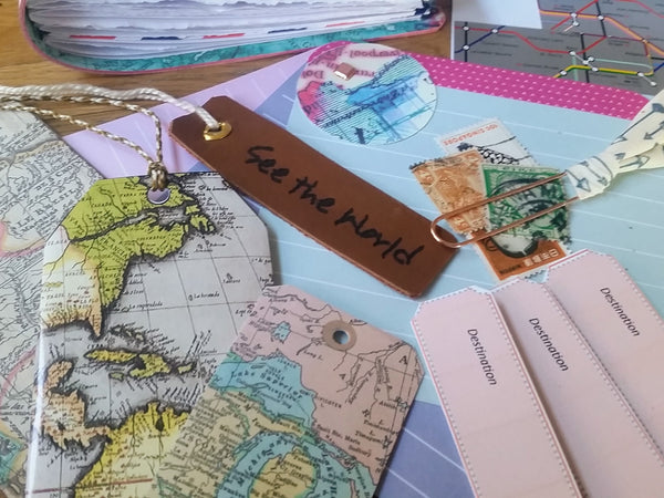 tags and stamps in a bespoke bindery leather travel journal