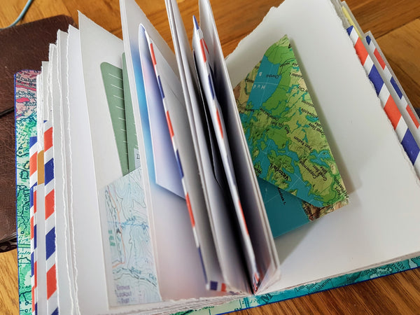 envelope pocket pages inside bespoke bindery travel journals