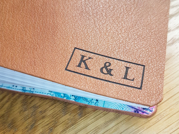A5 personalised leather travel journal showing laser engraved initials