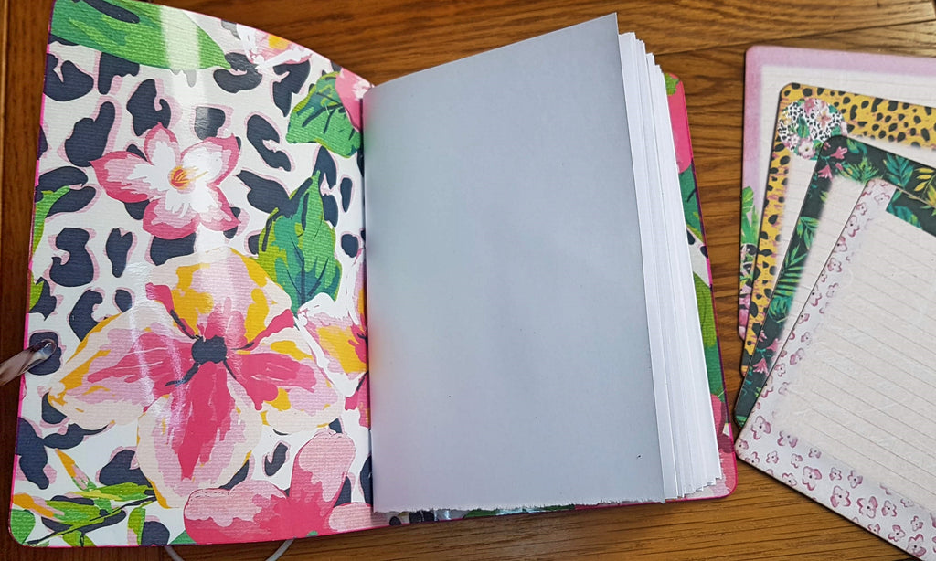 A6 size leather journal lined with large hawaiin floral print, bright white hand torn pages and 4 journaling cards in co-ordinating prints