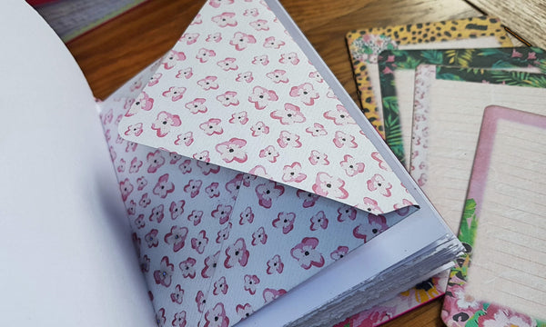 Small pink floral print paper envelope and co-ordinating journaling cards with leather journal by bespokebindery