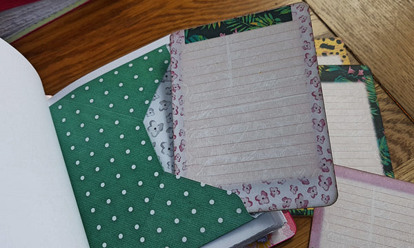 Green polka dot envelope and co-ordinating journal card inside bespoke binedery's Hawaii theme journal