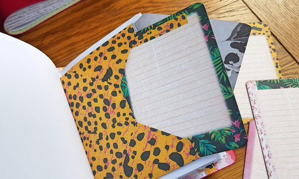 Yellow pink and black design on envelope and hawaii themed flora on journaling card