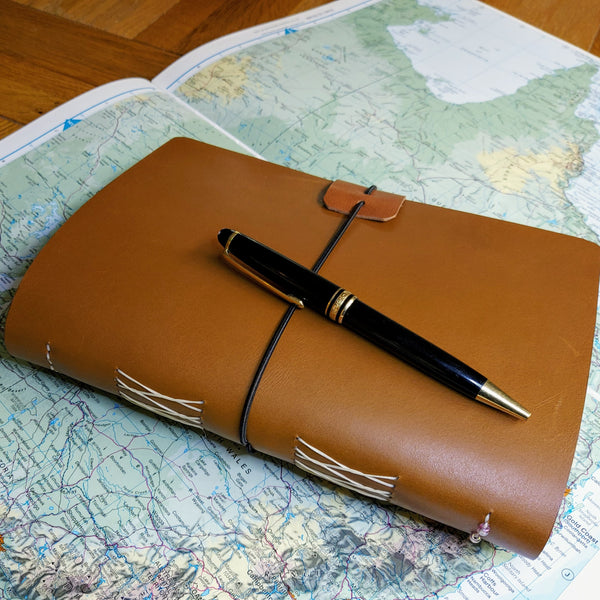 Leather Journal in Golden Brown Leather fastens with elastic loop.  Themed for Australia and showing Mont Blanc Pen