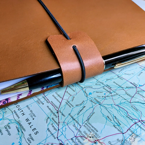 Golden Brown Leather Australia Travel Journal with protective edge cuff acting as pen loop