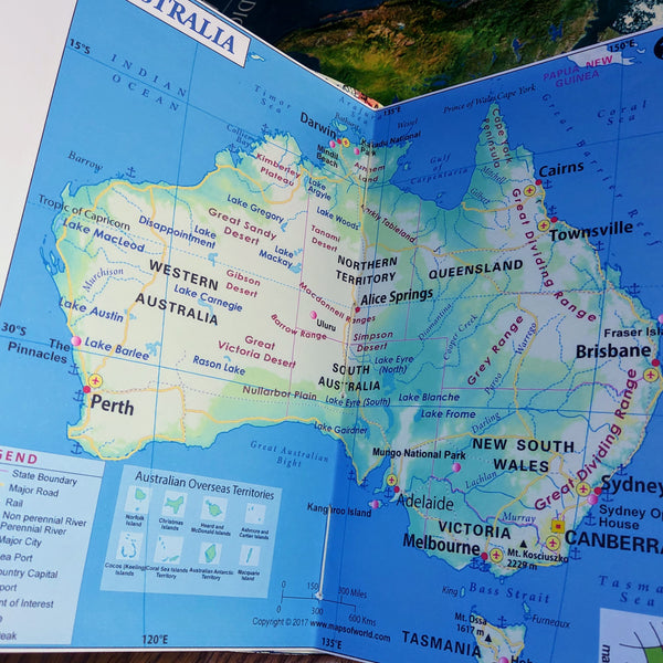 Blue map of Australia inside themed travel journal