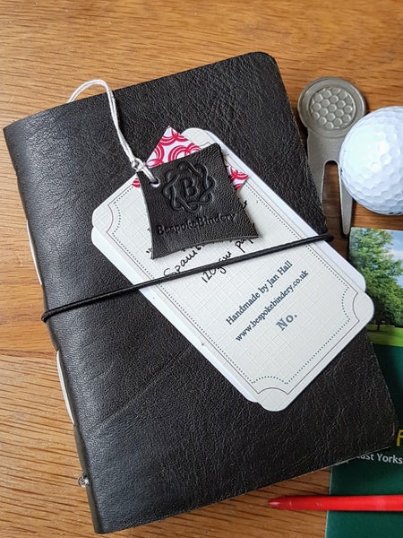 Men's golf score card log in darkest Green leather with numbered information tag